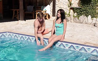 Energized teen fucks with the pool guy on holiday