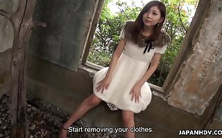 Depraved slim Japanese unladylike stripteases in deserted house and flashes hairy pussy