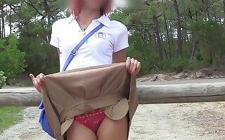 Skinny teen gets naked at beach