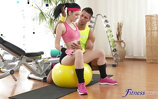 Perky brunette works out with a hunk before they fingers on fucking