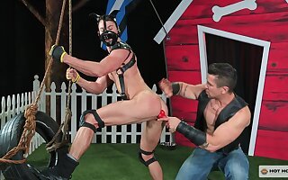 Outdoor gay humiliation with a teen dude abused in a leather mask