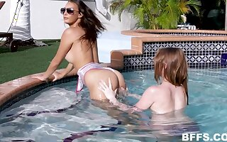 Alice Pink and her teen girlfriends share a cumshot by the pool