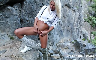 Light-complexioned tourist Claudia Macc is ready for some stripping outdoors and hot solo