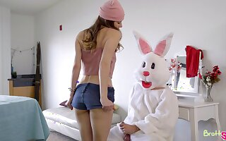 A man dressed not far from an Easter bunny costume fucks two uninhibited girls